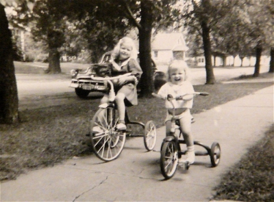 My mom, age 2 and her older sister zooming around the neighborhood. Beginnings of a future triathlete.
