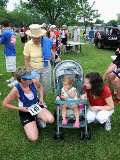 4 generations -- my grandma, my daughter and I congratulate my mom after a stellar triathlon finish