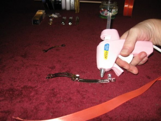 Glue the primary ribbon color to the back of the barrette.
