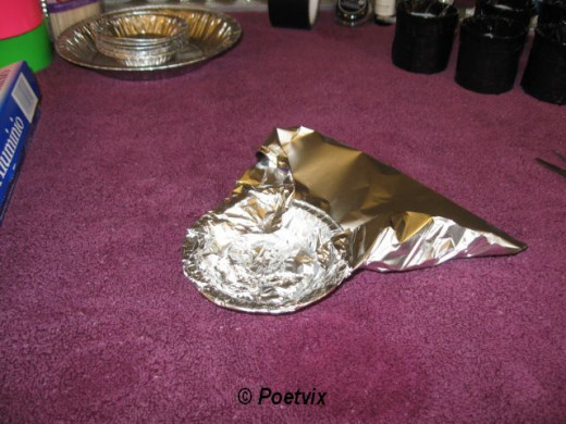 Cover the pie tins in tin foil.