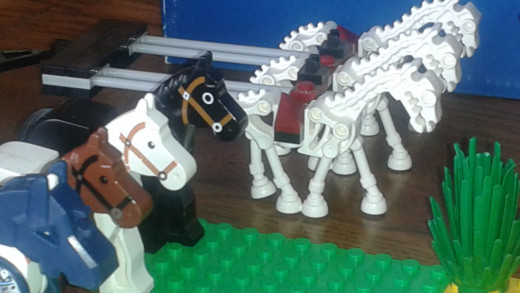Lego Horses.  One with armor, 3 skeletons, and 3 normal horses.