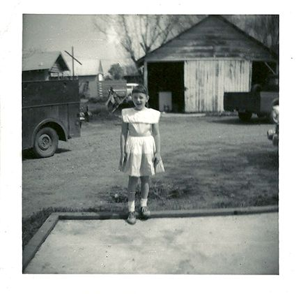 My sister posing for my Brownie.  Notice those Oxford shoes.  We wore those till they fell off.