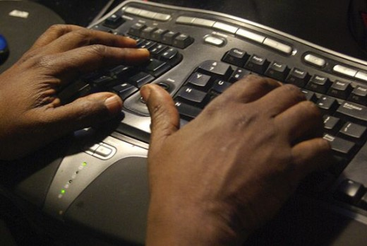My husband's hands working on his computer.