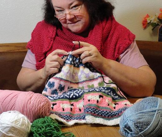 Photo Reference: myself knitting Fair Isle pattern