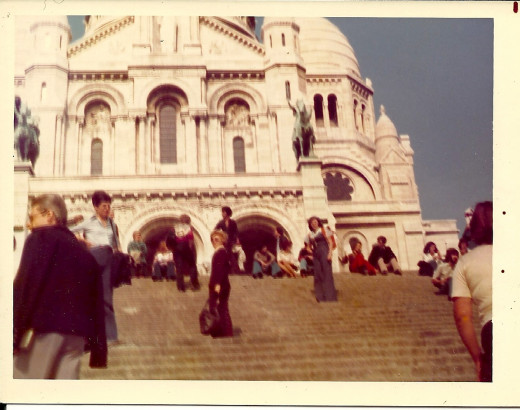 That's me on the steps of Sacred Heart with my baby daughter in the orange backpack carrier.