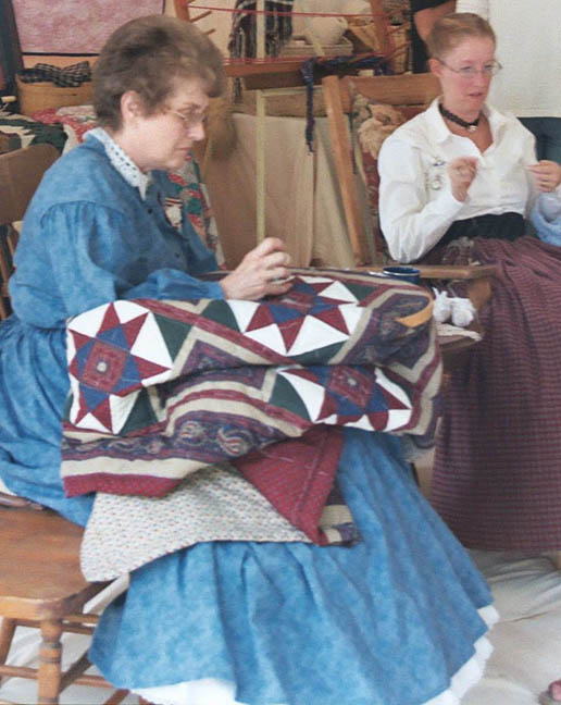 Photo of women sewing quilts at the Civil War Revisited weekend where a Civil War battle is recreated every year at the historic Kearney Park.
