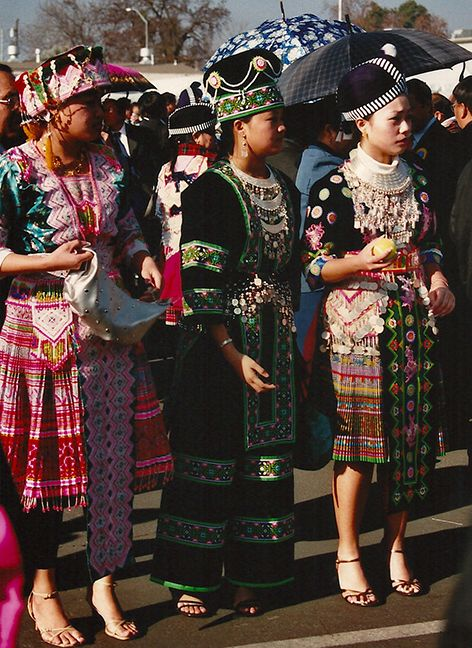 Another photo from the Hmong New Year celebration of girls in traditional costumes.