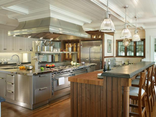 Stainless steel cabinets mixed with wood gives a warmer feel.photo courtesy of: hgtvremodels.com