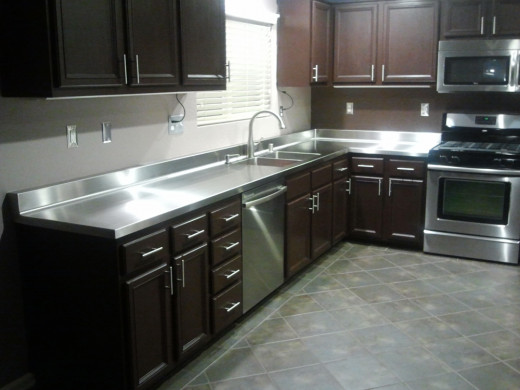 Stainless steel counter-tops can add just enough to give you a sleek look.photo courtesy of: fishprop.com
