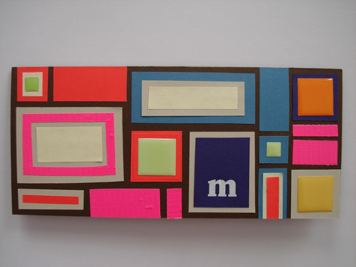 Very fun and modern design created by just cutting out different size paper squares and rectangles.