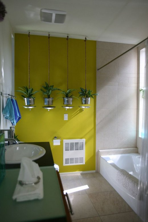 I love the modern planters set against the accent wall in this bathroom.