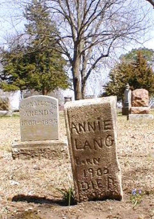 The stone in foreground is for Annie LANG, dau of Caroline Lang, born in 1908; died sometime after mid-1920.