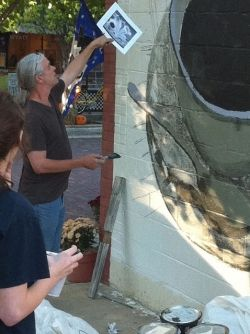 Wyatt Waters instructs painters for mural in Clinton, MS