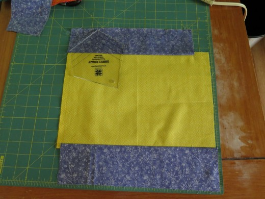 I had limited fabric in the mauve color, so I combined it with the yellow to cut out the shape.