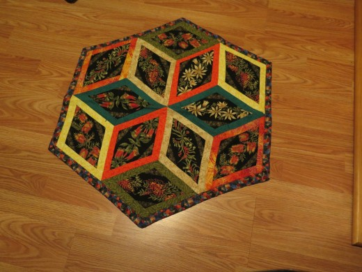 This quilt has to made with insets seams unless I make the left side of the cube a plain color.
