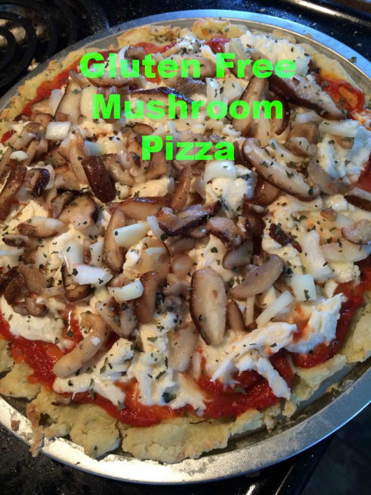 Gluten free pizza with mushrooms, onions, basil, and cheese.