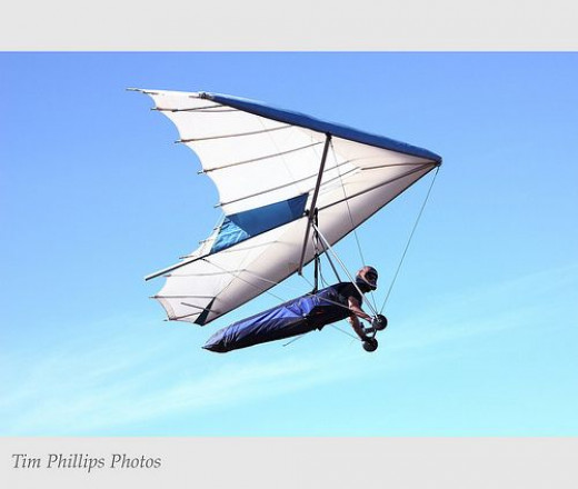 Doesn't have to be quite as extreme as hang gliding, but getting the adrenalin pumping helps your mood. Perhaps you could go on a rollercoaster, or try to overcome a fear?