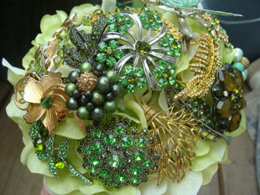 Vintage green brooches make up this brooch bouquet by estherleejewelry on Etsy. See the link below.