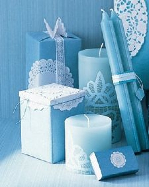 Use lacy doilies to decorate candles. Source: MarthaStewart.com. See link below for directions.