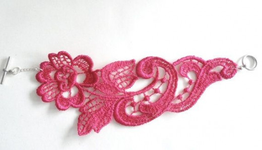 Pink lace bracelet made by White Bear Accessories on Etsy.