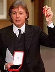 Sir Paul shows off his Knight Medal