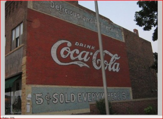 Coca-Cola sign on the side of a building.