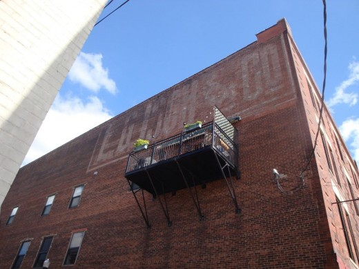 A ghost sign with a balcony beneath it. Love this one!