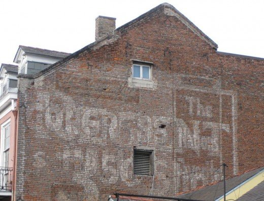 Layered ghost signs making it hard to read any of the words. Love it!