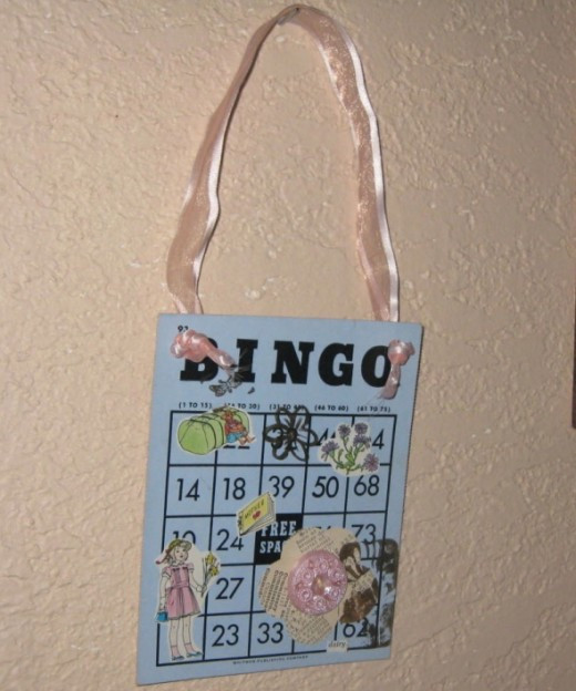 Bingo card art collage with vintage book illustration clip art and vintage button.