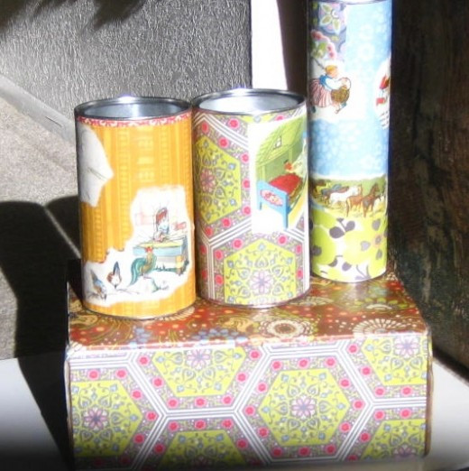 Use containers to make collages. Layer paper to add interest.