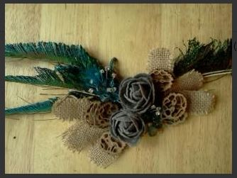 Decorative Wreath made by Heidi Tracy. Peacock feathers, roses and walnut slices