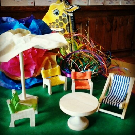 Time to redecorate that favorite dollhouse with brand new wooden patio furniture!  Comes with a simple collapsible umbrella, beach chairs, and table.