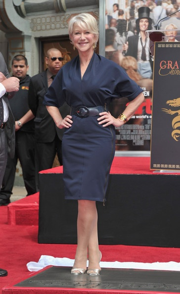 Mirren carries off this shirtdress in navy with particular panache. This is the power of personal confidence.