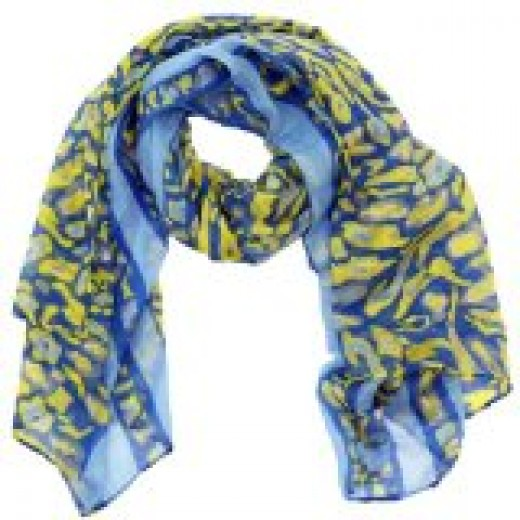 Scarves can be a versatile fashion accessory, quickly  adding color, disguising a less youthful neck, and lending a finished look.