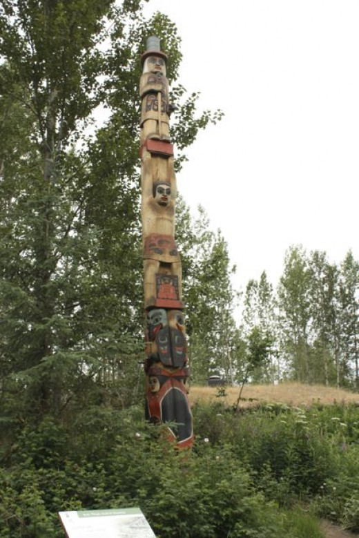 As we walked around the lake, the Tlingit clan house was the first we encountered. We were greeted by this totem pole with both a raven and an eagle.