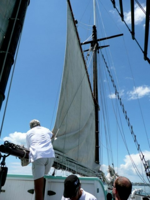 As it's time to head back to the museum dock, the crew bring down the main sail.