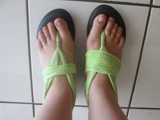 My super comfy lime green Sanuk Yoga Mat flip flops. Depending on my mood, I can roll up or spread out the cotton straps to change the width.