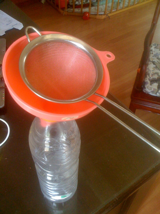 Strain it into a bottle. I like to use a sieve and funnel as shown.