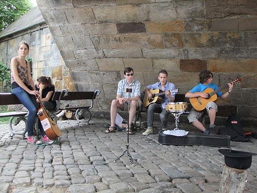 A group rehearses under a bridge in Prague