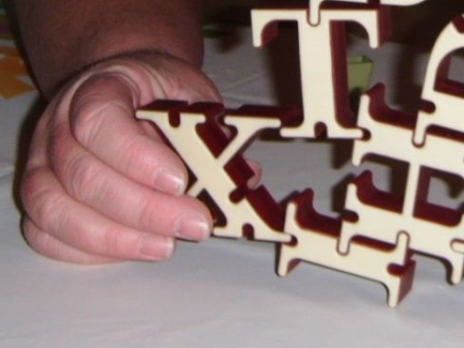 A steady hand rules the day when attaching letters to the tower.
