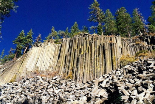 Looking up at the unusually formed rock formation.