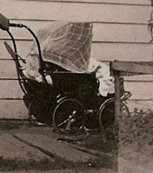From my personal collection, photo of an era baby carriage.