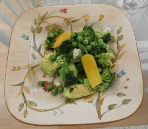 Mixture of steamed vegetables and avocado are ready for lunch