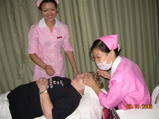 Facials with the beauticians dressed in shocking pink nurse outfits and a breast massage is part of the facial!