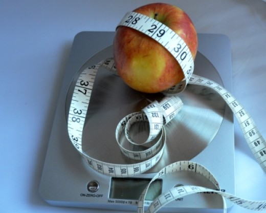 Apple, tape measure and scales