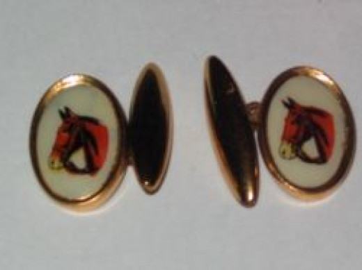 Gilt & celluloid horse cufflinks