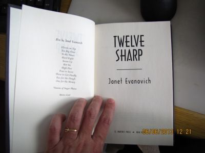 Holding in my hands Twelve Sharp, as I'm about to re-read it. It was so good!