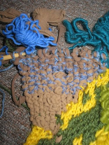 A section of the Riders of Rohan piece where I knit blue yarn with tan tights.