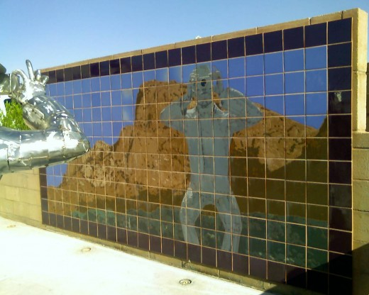 Reflection of man and Santa Catalina mountains which are across the street from the Oracle Crossings Shopping Center