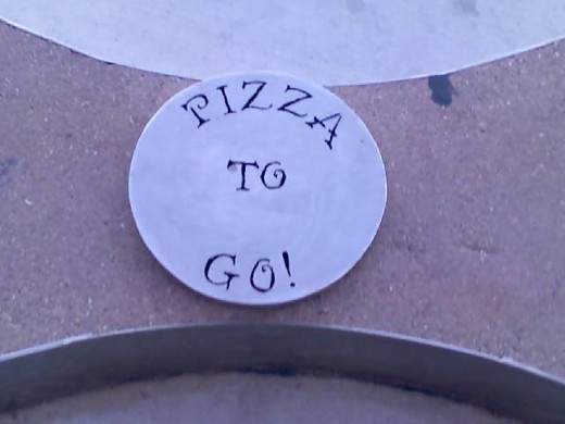 In case you didn't recognize the pizza the name plate beneath the sculpture gives it away.